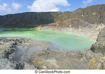 Volcanic crater lake - Green sulfuric lake in moderately...