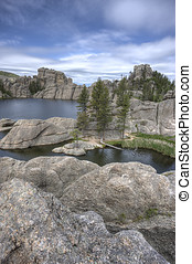 On the boulders of Sylvan Lake. - The rocky landscape...