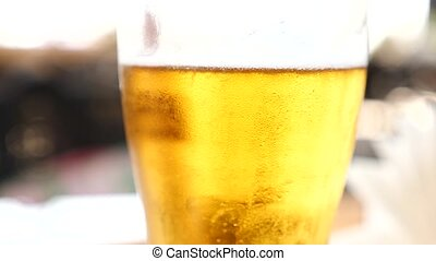 Beer in a mug close up. 4k. Slow motion, air bubbles in beer...