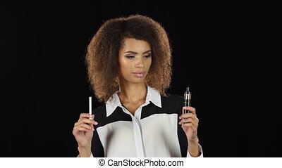 Young woman have a choice between tobacco cigarette and...