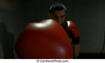 Slow motion of young fighter punching in a boxing fight