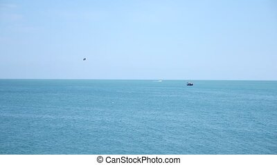 Motor boat boat, paragliding over the sea, Parachute over...
