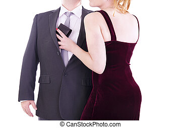 Woman pulls out wallet from a pocket of the businessman.  Isolated on white background.