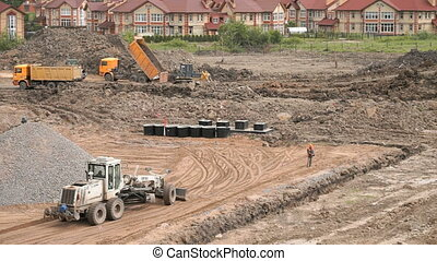 Construction working process. Construction site - Bulldozer...