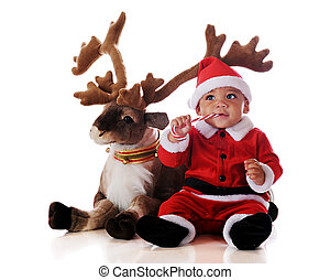 Santa and Reindeer - An adorable biracial Santa eating a...