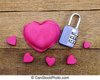 lock with the heart as a symbol of love vintage on wooden...