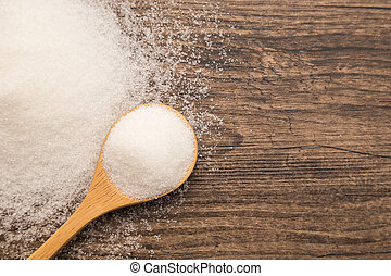Pile of sugar on wooden plank background. Use for Diabetes...