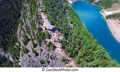 Banff park aerial mountains - Flying over lake mountains...