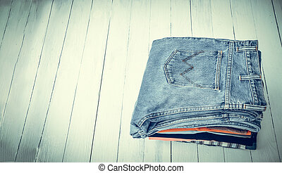 jeans put on wooden - pile of jeans put on a wooden...