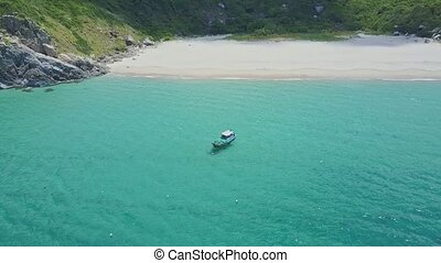 Drone Shows Boat on Azure Ocean by White Sand Beach - Drone...