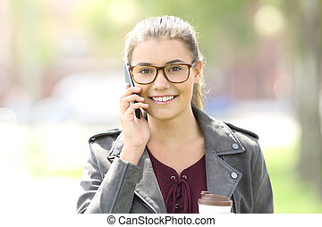 Front view of a fashion girl talking on the phone
