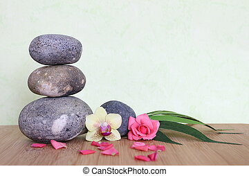 Decorative pebbles stacked in a Zen life fashion on a bamboo...