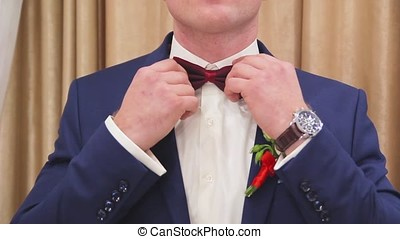 A man in a jacket on a light background, a groom's fees