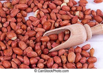roasted peanuts with spatula close up photo