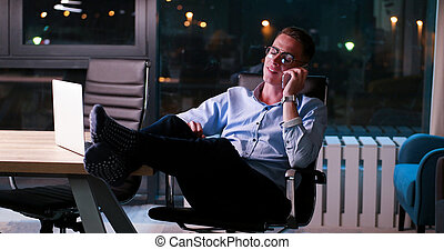 businessman sitting with legs on desk at office - Full...