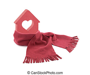 Small red house with heart wrapped in a scarf isolated on white