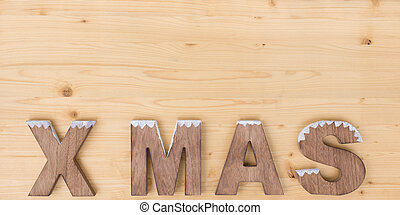 X MAS - The word X MAS made on wood on wood