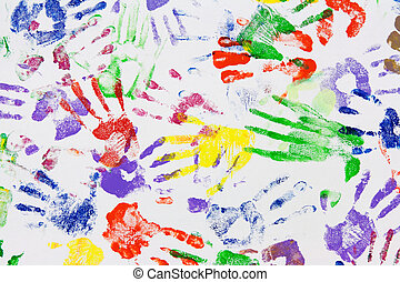 Varicoloured imprint of the hands on white canvas