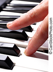 hands playing music on the piano, hands and piano player,...