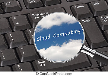 Cloud computing - Magnifying glass showing clouds on a...
