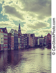 Amsterdam canal Singel with typical dutch houses Holland,...