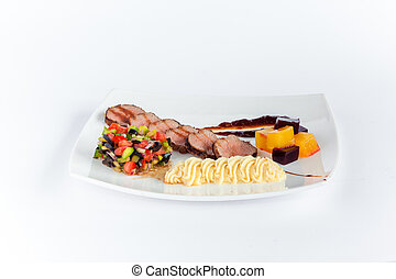 Close Up of Rack of Saucy Barbecue Pork Served on Plate in...