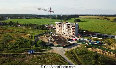 Aerial view of multi-storey building construction at summer...