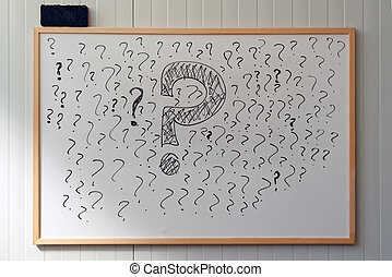 Many question marks on office whiteboard, uncertainty and...