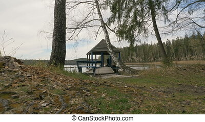 Young girl relaxes in the summer house on the lake -...