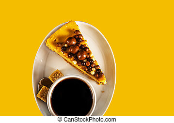Aromatic black coffee in white cup with cheesecake on white saucer, brown sugar, teaspoon, yellow backround