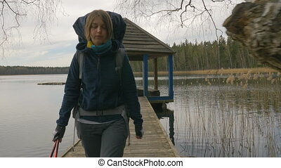 Young girl goes from the summer house on the lake -...