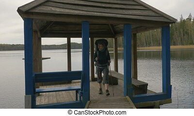 Yonug girl goes from the summer house on the lake -...