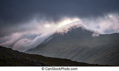 Time Lapse - Very Fast Clouds Covering Mountain At Molls...