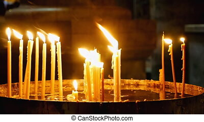 Burning candles in Holy Sepulcher Church - Jerusalem, Israel...