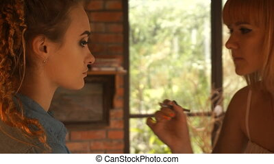 makeup artist paint brush lips young girl