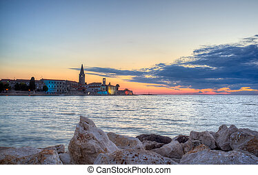 Porec skyline and sea at sunset - View of Porec skyline and...