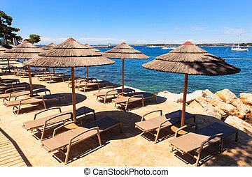 Beach umbrellas in Saint Nicholas island, Porec - Beach...