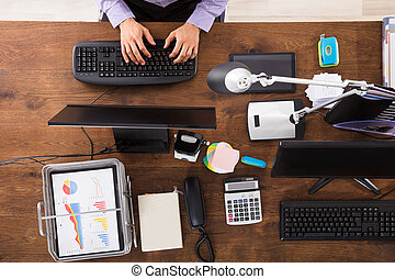 Elevated View Of Businessperson Working On Computer Over...