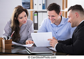 Advisor Discussing With Couple - Couple Talking With Advisor...