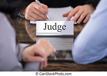 Judge Name Plate On Desk - Close-up Of A Judge With The Name...