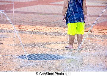 little girl playing in splash pad - little girl in city...