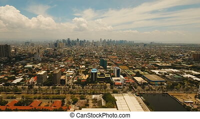 Aerial city with skyscrapers and buildings. Philippines,...