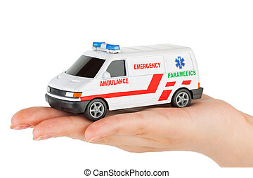 Hand with toy ambulance car