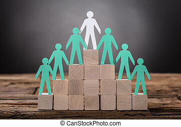 Paper Boss With Employees Standing On Wooden Blocks -...