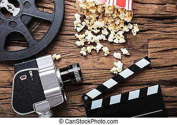 Movie Camera With Film Reel  Clapper Board And Popcorn