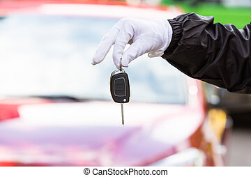 Valet Holding Car Key - Close-up Of A Valet Wearing Glove...