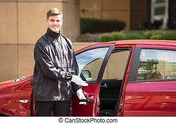 Happy Male Valet Opening Car Door - Portrait Of A Happy...
