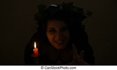 Scary vampire woman with black veil snarling in the darkness...