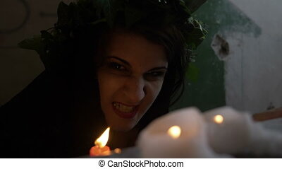 Closeup of demonic possessed girl provoked into a dark room