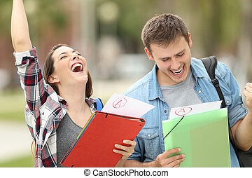 Excited students with approved exams - Two excited students...